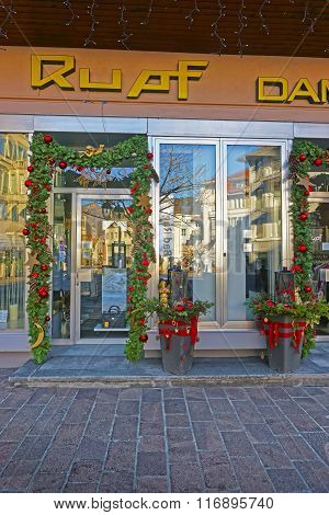 BAD RAGAZ - JANUARY 1 2014: Shop Entrance with Christmas decor. Bad Ragaz is city in St. Gallen in Switzerland. It lies over Graubunden Alps. Spa and recreation village is at end of Tamina valley