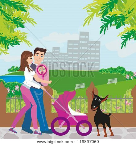 Family Walk In The Park With An Infant