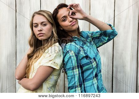 Two friends making posing and making gesture at camera