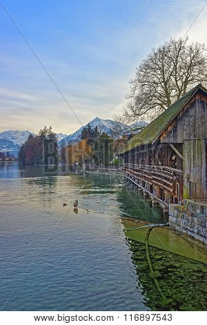 Old Wooden Sluice bridge in Thun Old Town. Thun is a city in Swiss canton of Bern where Aare river flows out of Lake Thun.