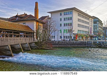 THUN SWITZERLAND - JANUARY 1 2014: Fragment of Old Wooden Sluice bridge in the Old City of Thun. Thun is a city in Swiss canton of Bern where Aare river flows out of Lake Thun.
