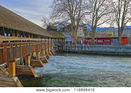 Fragment of Old Wooden Sluice bridge in the Old Town of Thun. Thun is a city in Swiss canton of Bern where Aare river flows out of Lake Thun.