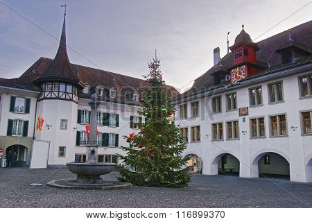 Town Hall Square with a Christmas tree in the Old Town of Thun. Thun is a city in Swiss canton of Bern where Aare river flows out of Lake Thun. Town Hall Square is a historic center of the city