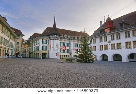 Town Hall Square with a Christmas tree in the Old City of Thun. Thun is a city in Swiss canton of Bern where Aare river flows out of Lake Thun. Town Hall Square is a historic center of the city