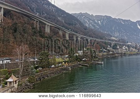 Long bridge in Montreux city center in winter. Montreux is a city in the canton of Vaud in Switzerland. It is located on Lake Geneva at the foot of the Alps.