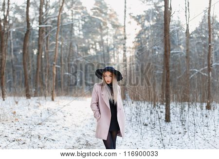 Pretty Fashionable Woman In Black Hat And Pink Coat In Winter Amazing Woods At Sunset