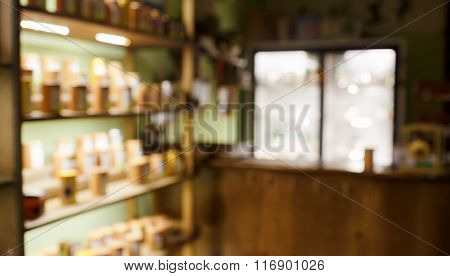 Tea Coffee Shop Interior Blurred Abstract Background, Shelves With Samples, Back Light And Bar Illum