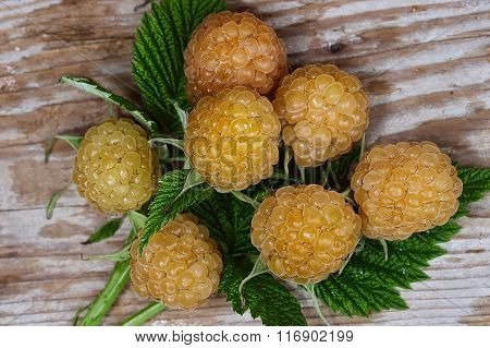 Yellow raspberry on a wooden table