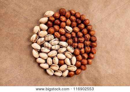 Yin Yang made of pistachios and hazelnuts