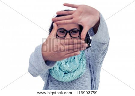 Asian woman making square with hands on white screen