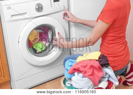 Woman and a washing machine.