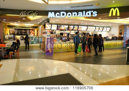 HONG KONG - JANUARY 27, 2016: interior of McDonald's restaurant. McDonald's primarily sells hamburgers, cheeseburgers, chicken, french fries, breakfast items, soft drinks, milkshakes, and desserts