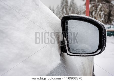 Car's Wincar's Window Frozen And Car's Mirror Covered With Snow In The Winter Daydow Frozen And Cove