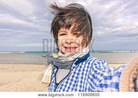 Little Smiling Child Taking Selfie Making Selfie Portrait Photo - Small Fashion Boy Having Fun In Cl