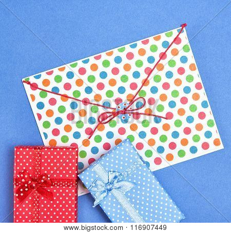 Blue And Red Gift Boxes With Envelope