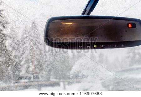 View Through The Cars Windshield  In The Winter Snowy Day On The Road