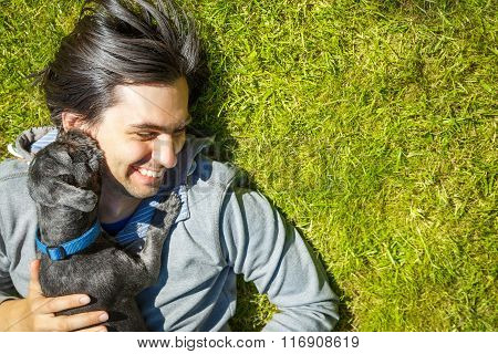 Little Pet Dog and His Owner Having Fun Outdoors