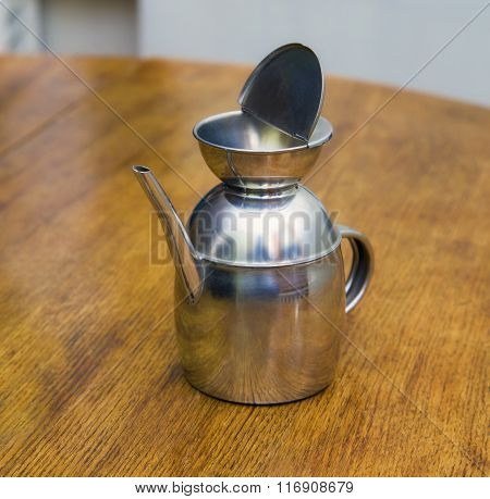 Old Metallic Coffee-pot - Teapot On A Wooden Table