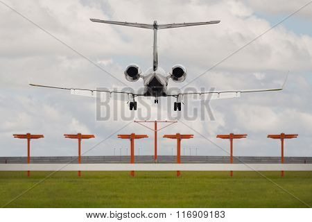 Rear view from the runway of a jet landing