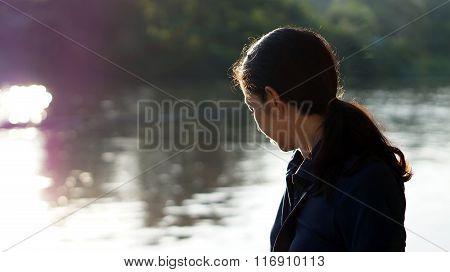 Asian Girl Potrait Near River In Morning Sun