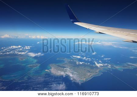 Wing Of Airplane Above Many Islands