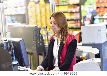 Portrait of smiling cashier working in grocery store