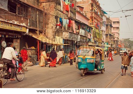Autorickshaw In Indian Style Driving Through Busy City Street