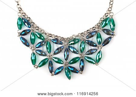 Detail of a Silver necklace with blue and green rhinestones