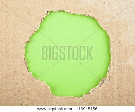 Ripped Hole In Cardboard On Pink Background