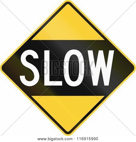 An Older Version Of The Road Sign In The United States Warning Drivers To Proceed Slowly Or Slow Dow