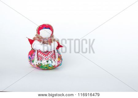Doll Amulet On A White Background
