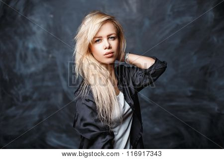 Portrait Of A Beautiful Young Woman With Blond Hair In A Black Shirt And A White Shirt On A Dark Bac