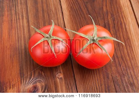 Ripe Tomatoes Closeup On Wooden Background.