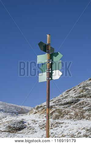 Blank Green Directional Signs In Mountain