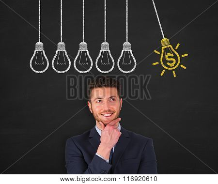 Finance Idea Light Bulb Concept Drawing Work on Blackboard