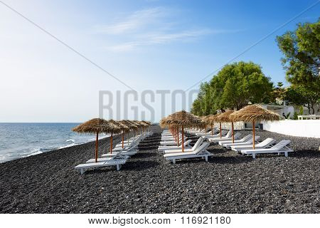 The Beach With Black Volcanic Stones At Santorini Island, Greece