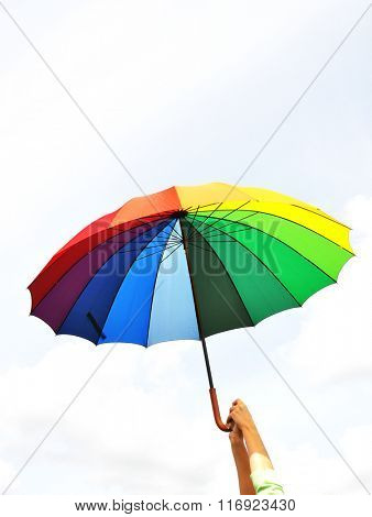 Rainbow umbrella in the hand