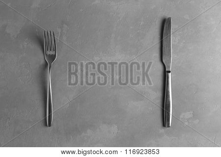 Fork And Knife On The Concrete Background