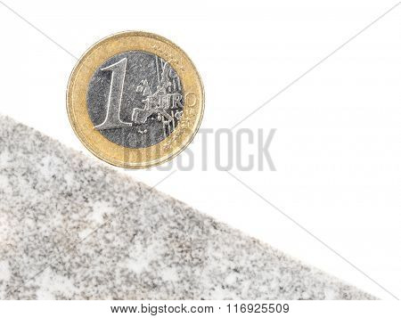 One Euro coin on inclined plane as a metaphor of currency crash