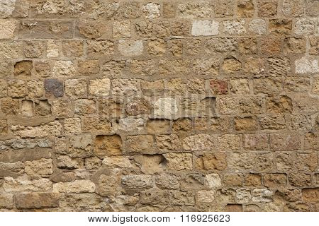 Medieval stone wall in Cordoba, Andalusia, Spain. Background texture.
