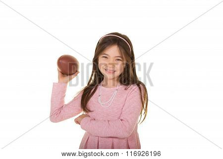 School aged child with a football