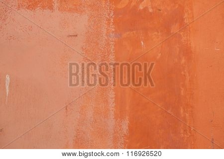 Terracotta painted stucco wall. Background texture.