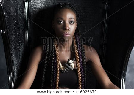 confident   calm braided afro-american woman sitting