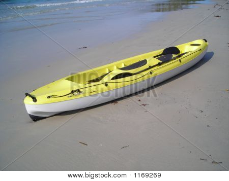 Single Yellow Canoe On The Beach