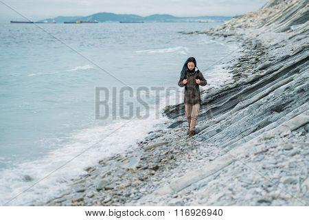 Girl Walking On Coast