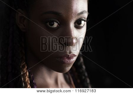 face of young afro-american braided woman