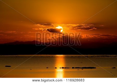 Scenic View Of Beautiful Sunset Over Lake.