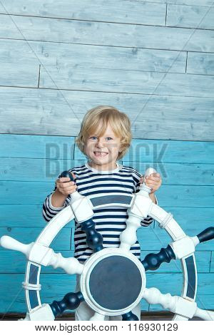 child holding a steering wheel