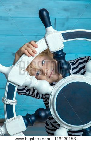 child looking through the wheel