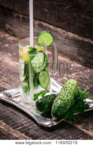 Fresh cold cucumber drink on wooden table
